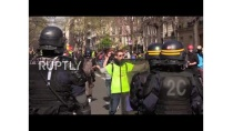 France: Police fire tear gas as Yellow Vests march for 21st straight week